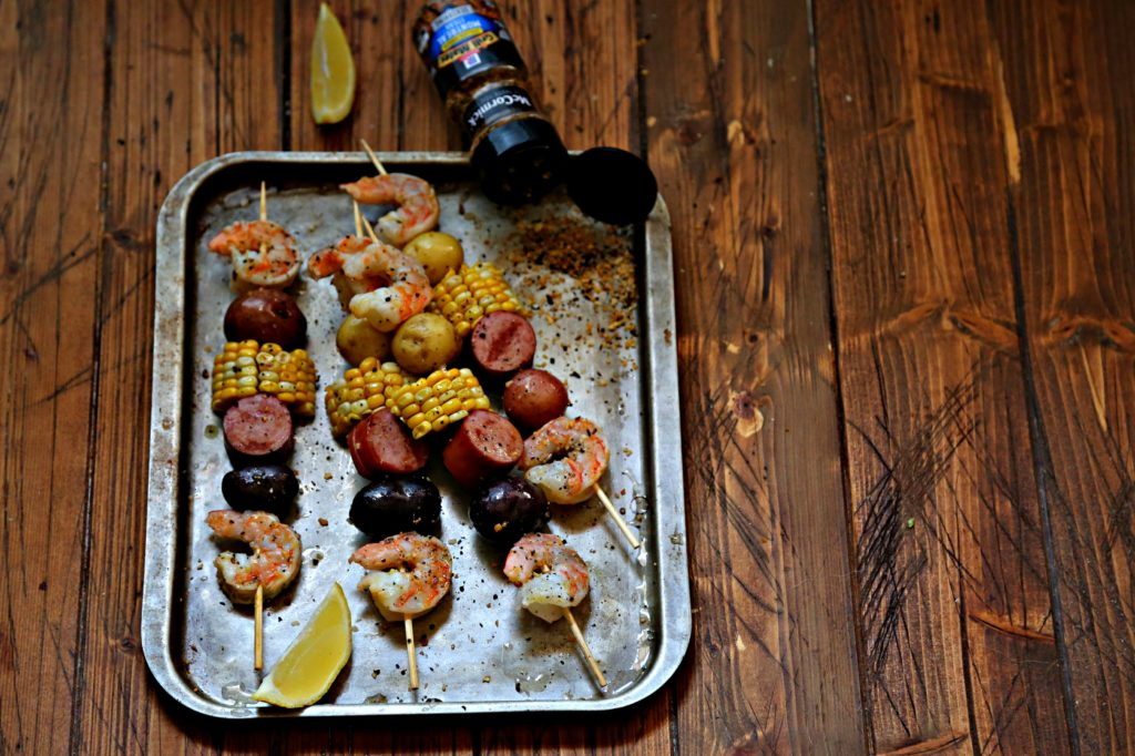 low country boil kebabs on baking sheet.