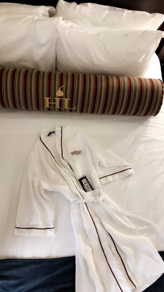bed with hershey robe and chocolate bar.