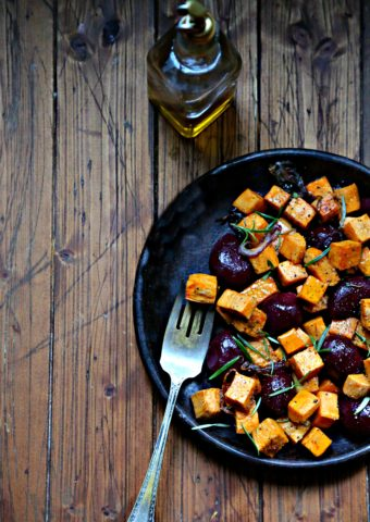 Roasted Sweet Potatoes and Beets on brown plate with fork.