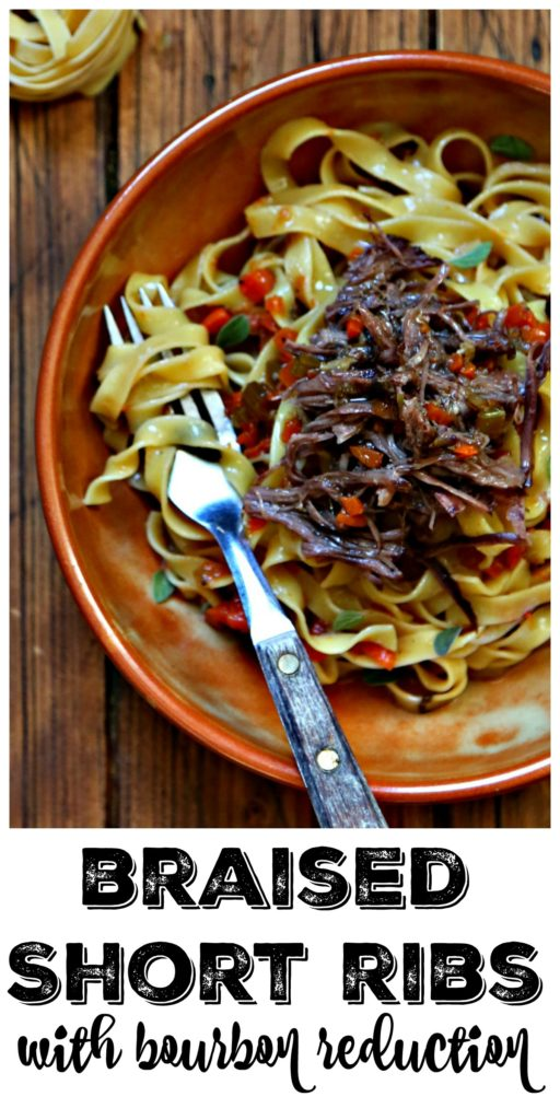 bowl of pasta with shredded short ribs and fork.