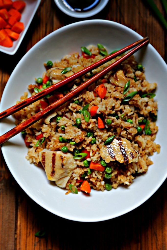 Chicken fried rice in white bowl with chopsticks