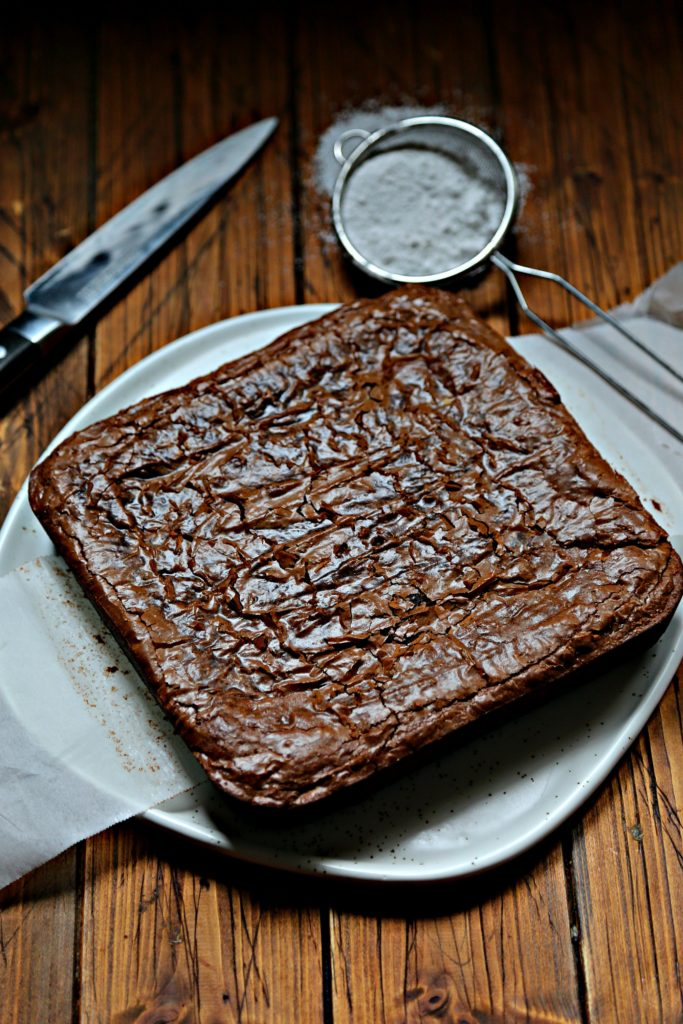 brownies on white plate with knife.