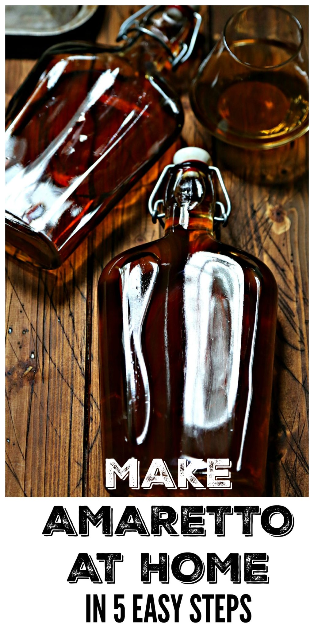 Glass Bottle with stopper of homemade amaretto with small white bowl of brown sugar in background pinterest image via Bell'Alimento