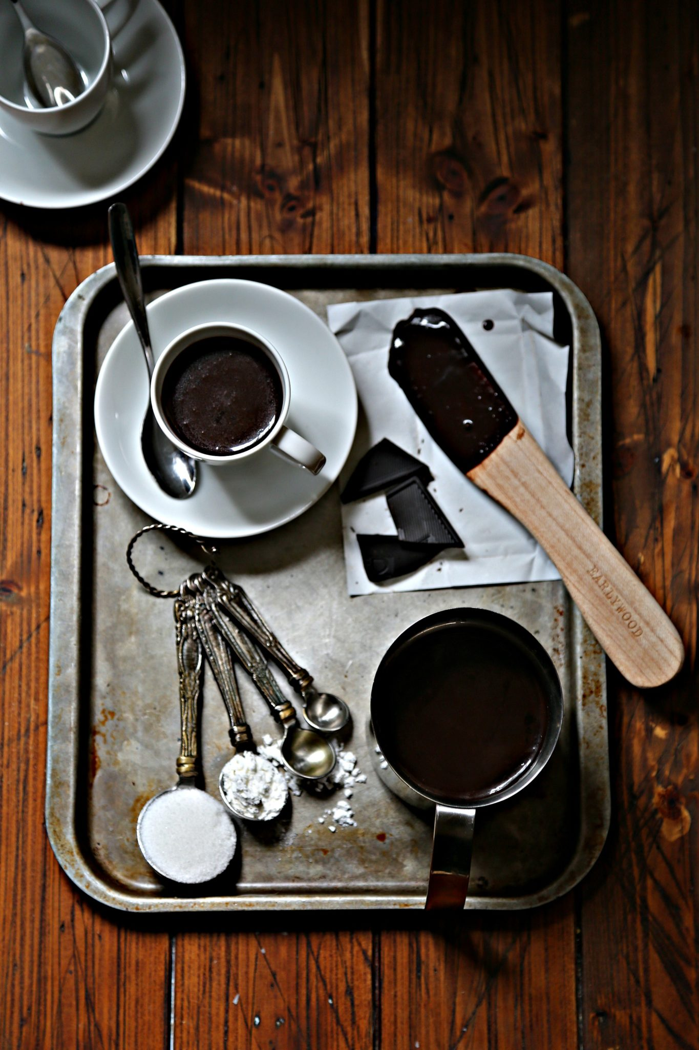 Italian hot chocolate on silver tray with spoon and ingredients via bell'alimento