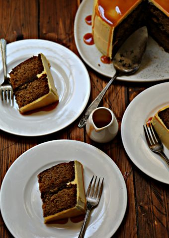 apple spice cake on white platter. 3 white plates with slices of cake with forks scattered around.