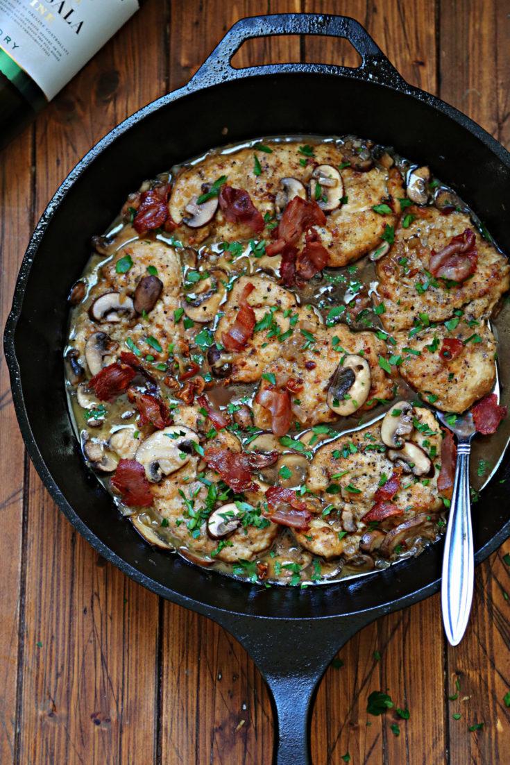 ThisChicken Marsala recipe (aka Pollo al Marsala) is comprised of pan-fried chicken cutlets and mushrooms in a rich Marsala wine sauce.