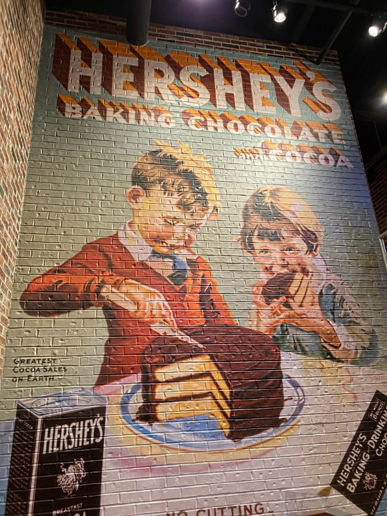 mural of 2 children frosting, eating cake at Hershey