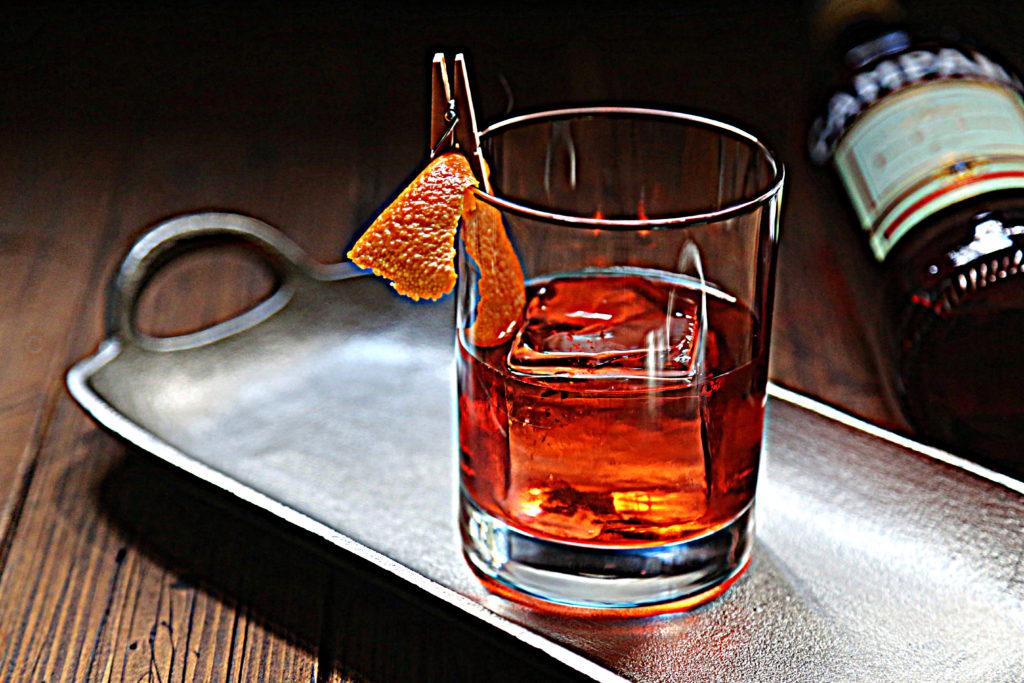 negroni cocktail on silver tray.