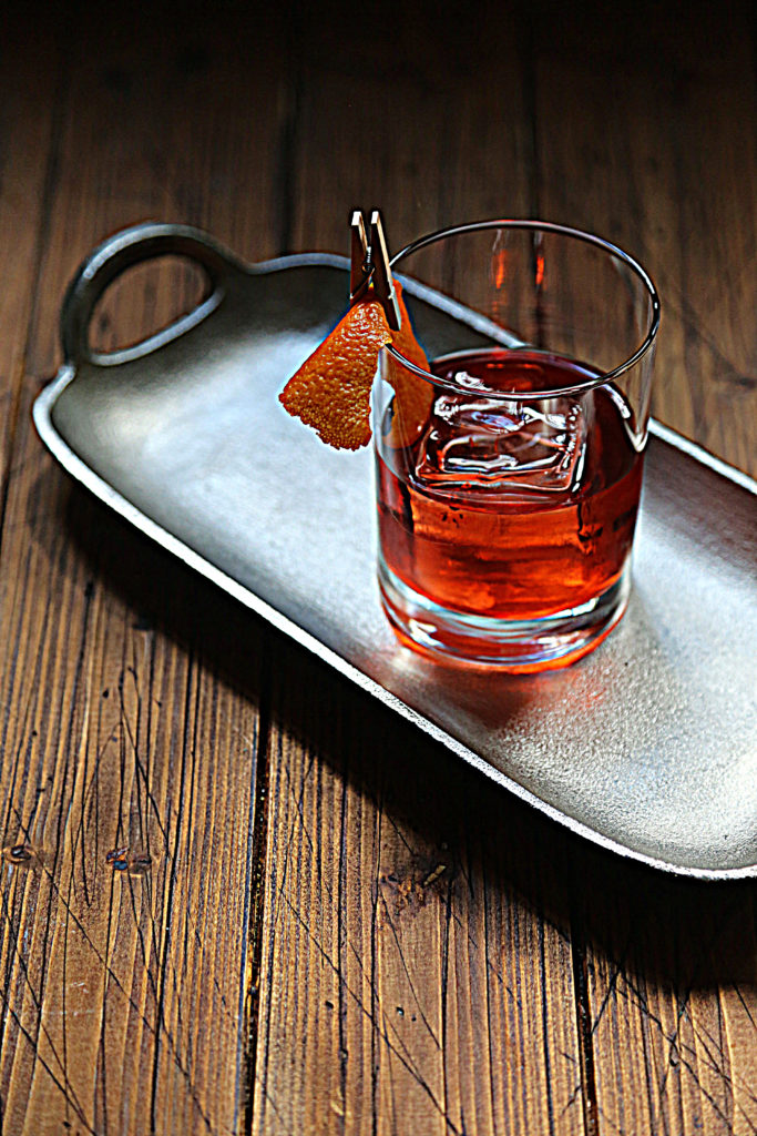 negoni cocktail on silver tray.